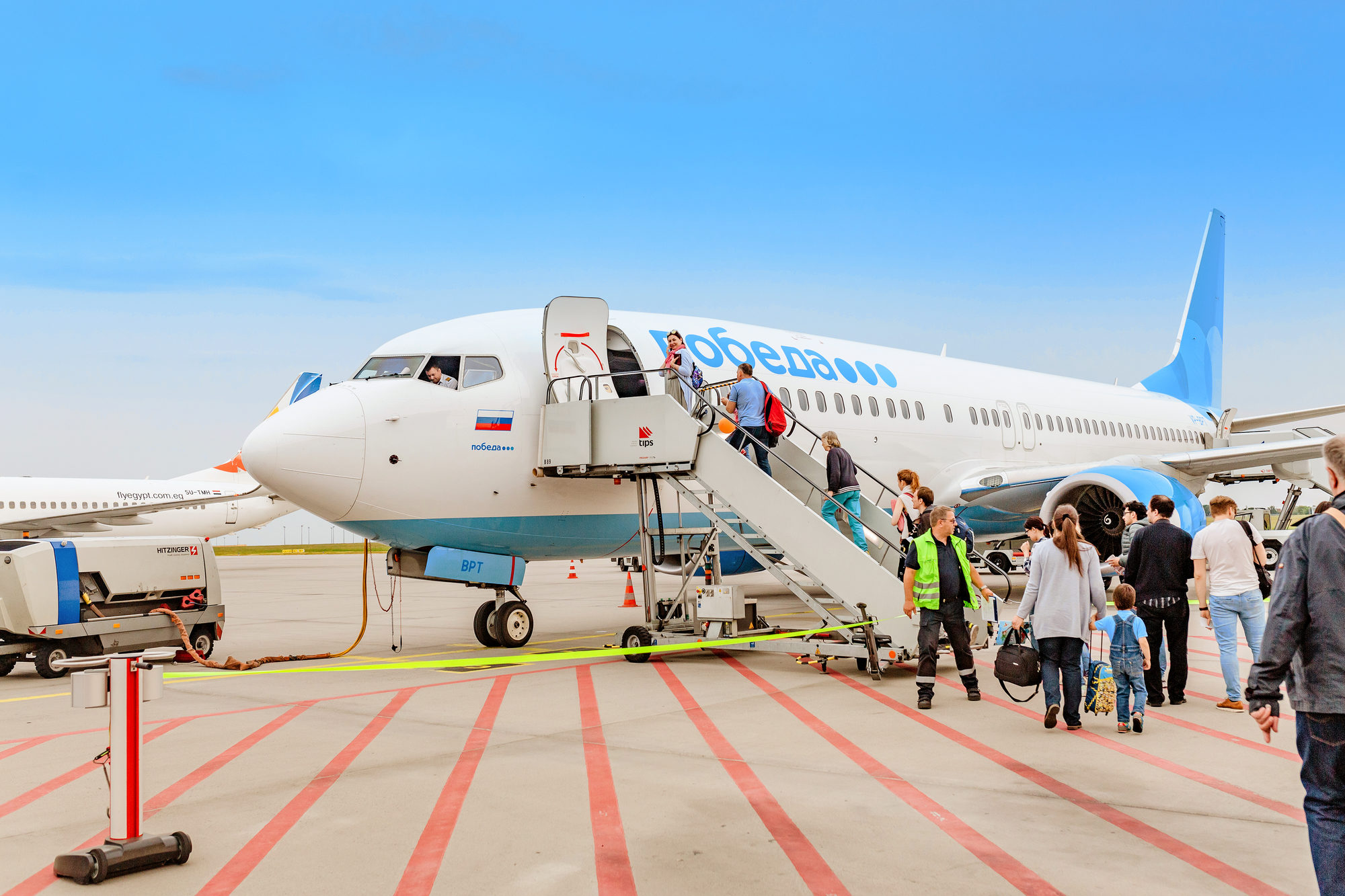 halle-airport-germany-may-23-2018-boarding-on-pobeda-airlines-russian-lowcost-jet-airplane-in-airport
